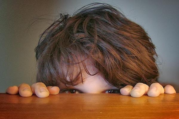 kid behind desk